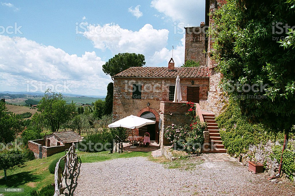 tuscan holiday villa with blue sky gravel courtyard stock photo