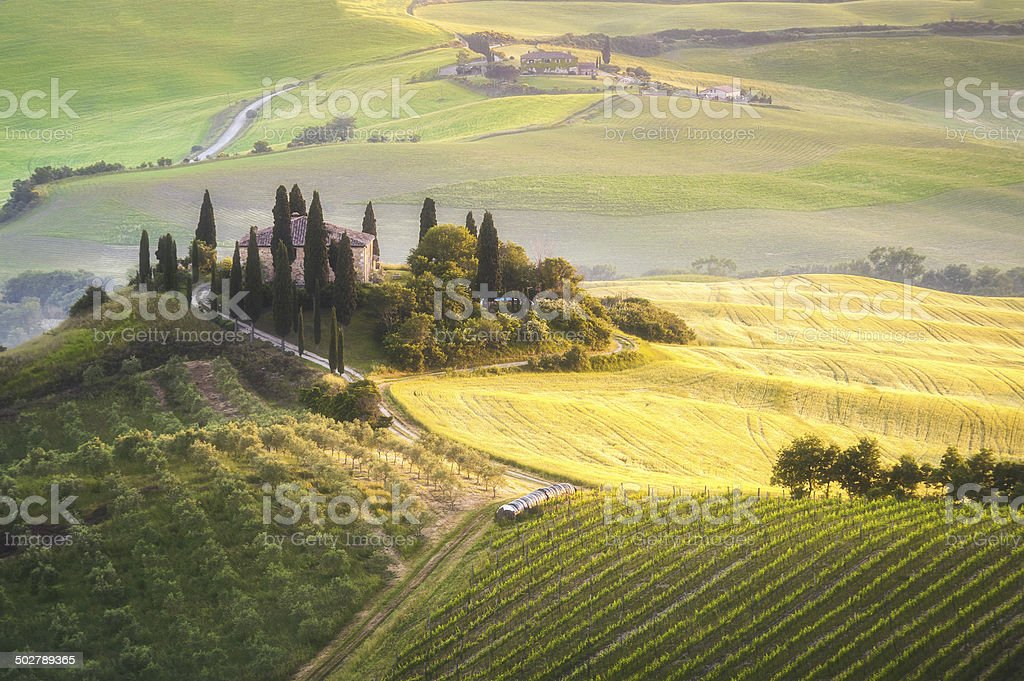 Tuscan house on the misty hills stock photo