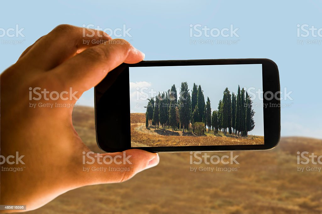 Tuscan landscape on mobile phone stock photo