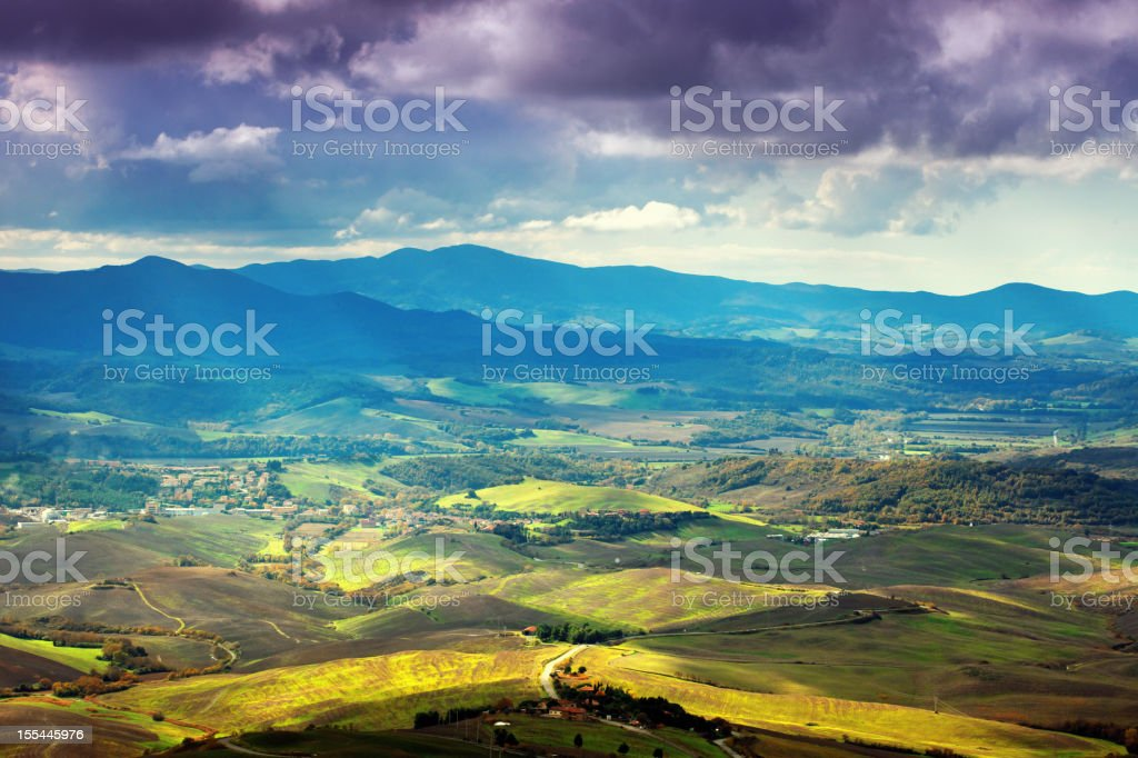Tuscan landscape with heavy clouds stock photo