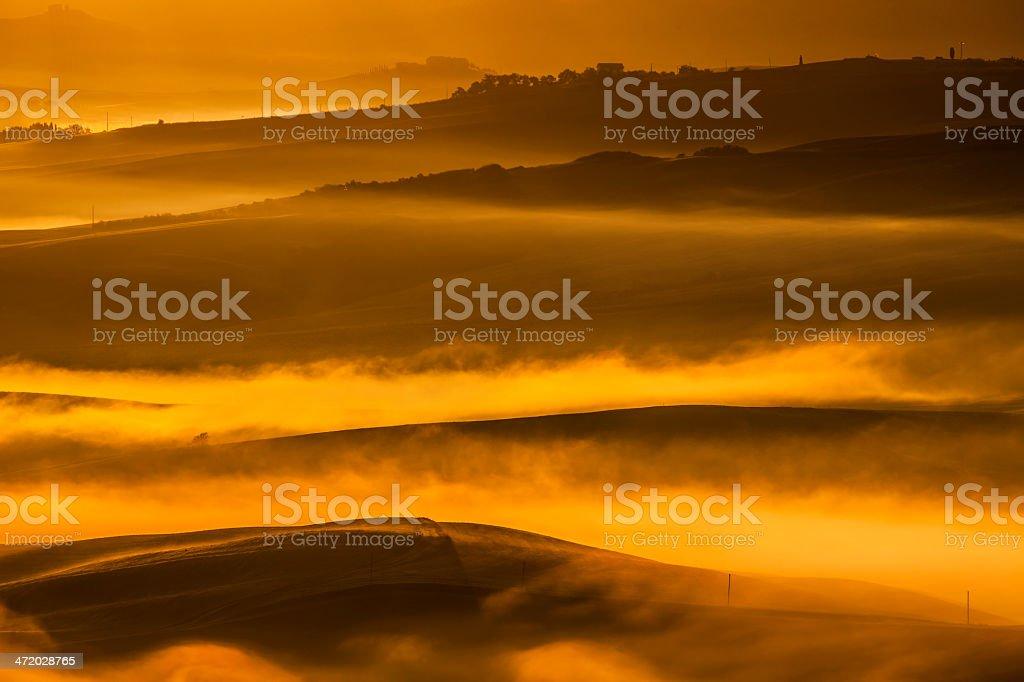 Tuscan Landscape With Morning Fog Illuminated By Sunrise royalty-free stock photo