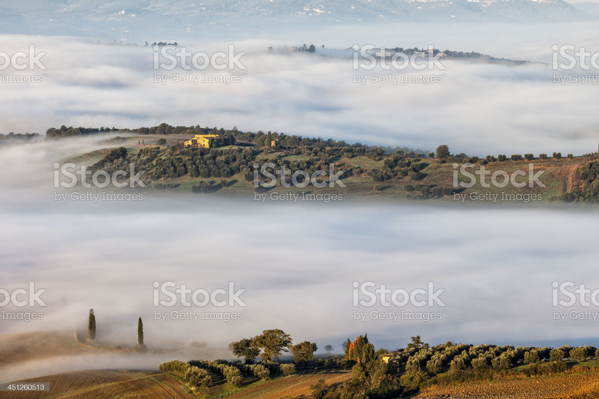 Tuscan Landscape With Morning Fog royalty-free stock photo