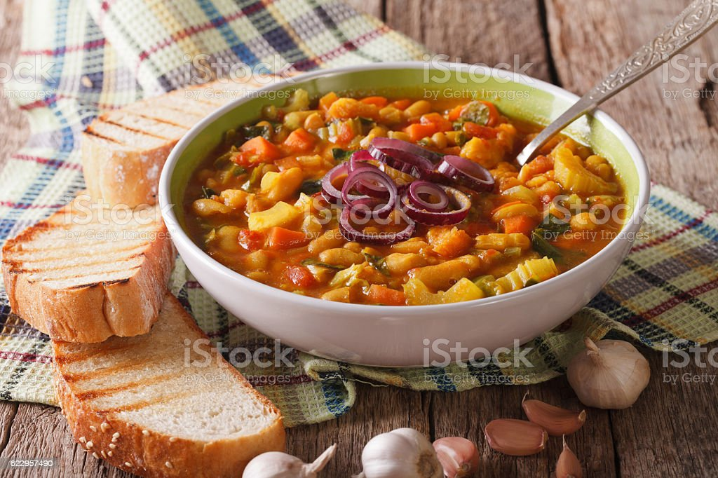 Tuscan ribollita thick soup with bread closeup on the table stock photo