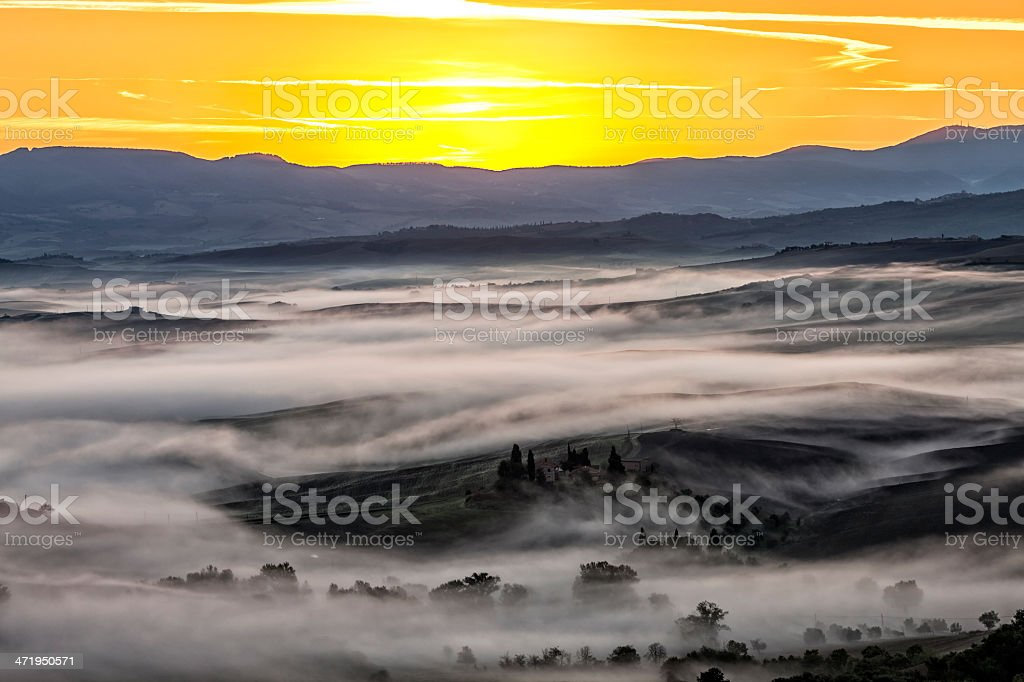 Tuscan Valley Covered With Fog at Dawn royalty-free stock photo