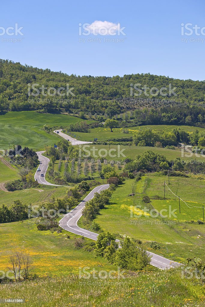 Tuscan view with local curve road royalty-free stock photo