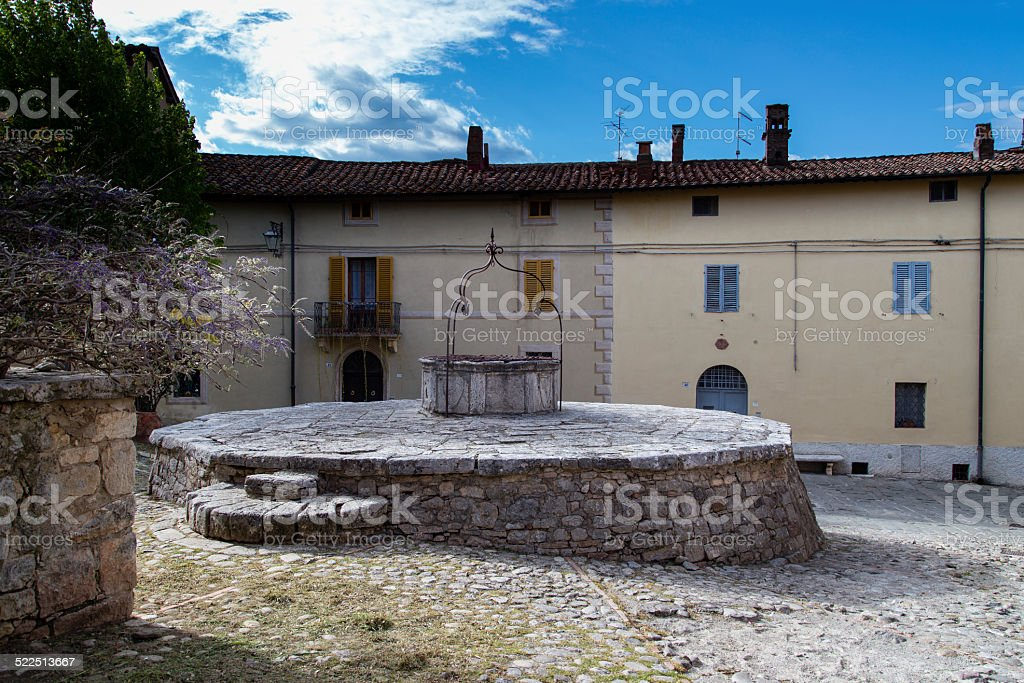 Tuscan Village with well stock photo