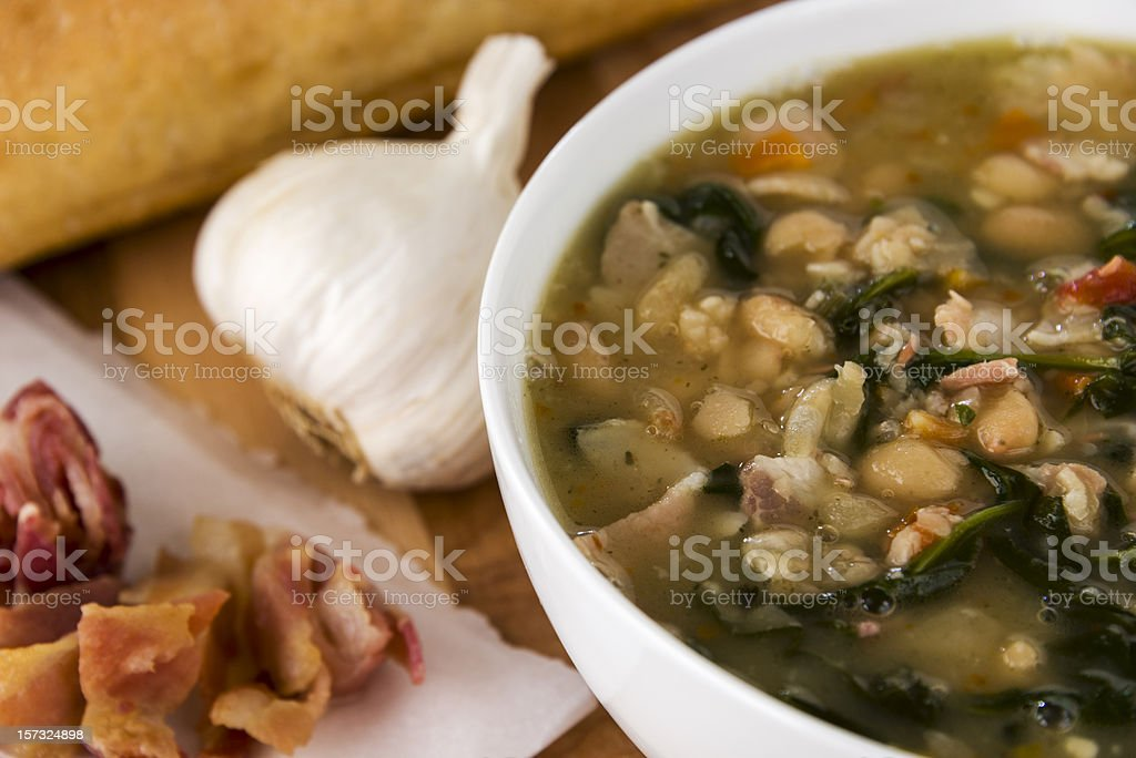 Tuscan white bean soup with pancetta and garlic stock photo