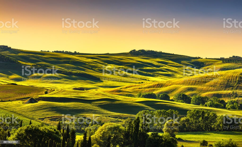 Tuscany countryside landscape panorama at sunset, rolling hills, fields, meadow. Italy stock photo