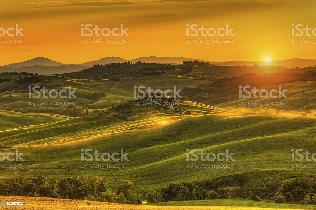 Tuscany Farmhouse at Sunset in Val d'Orcia stock photo