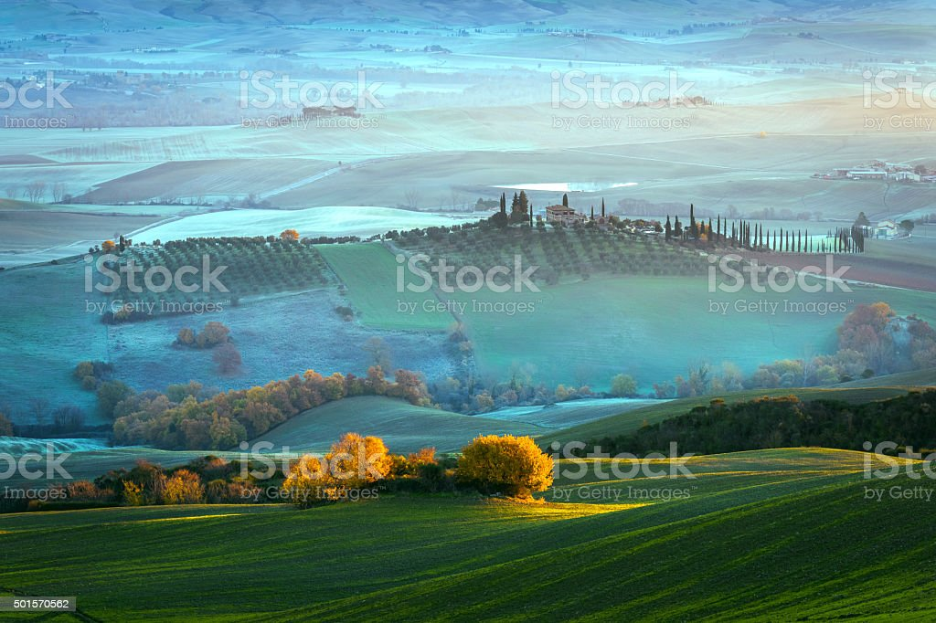 Tuscany farmhouse,morning, frost, winter, mist,Italy. stock photo