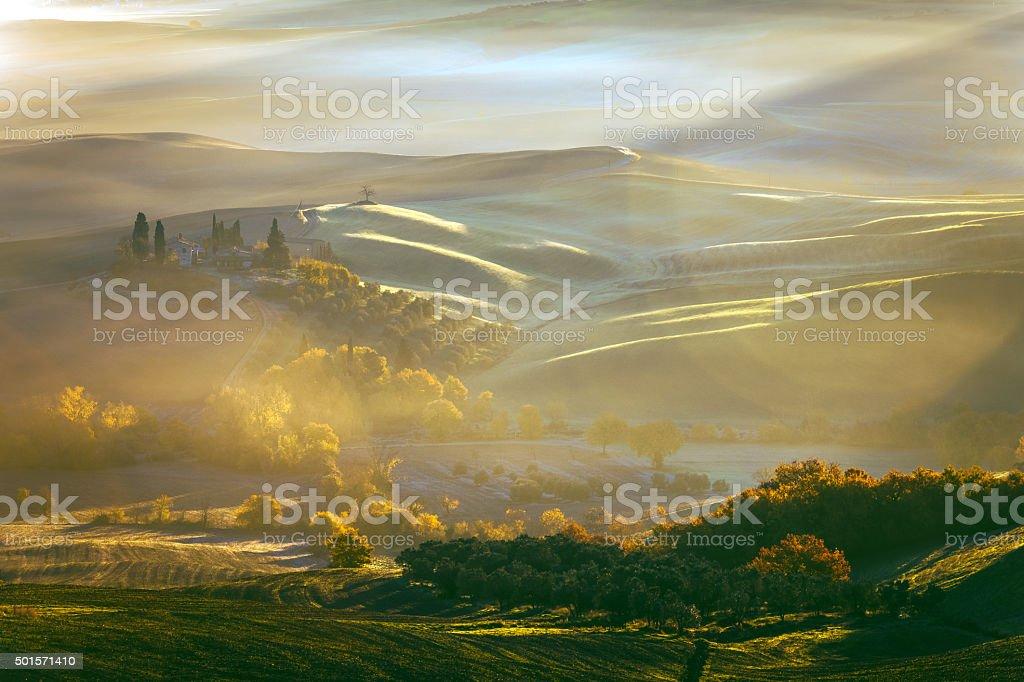 Tuscany farmhouse,morning, frost, winter, mist,Italy. stock photo