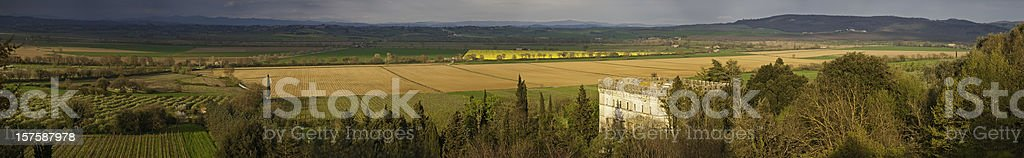 Tuscany golden sunlight vineyards villages valleys villas Siena Italy panorama royalty-free stock photo