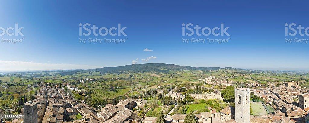 Tuscany historic hilltop town rooftop vista villas vinyards panorama Italy stock photo