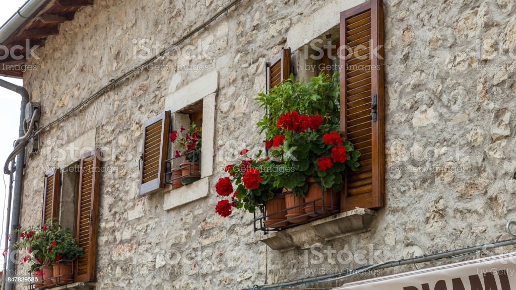 Tuscany house and flowers stock photo