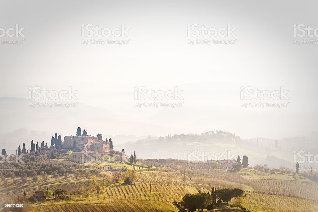 Tuscany iconic hilltop villages farmhouses vinyards cypress trees Italy stock photo