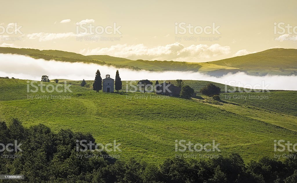 Tuscany landscape in morning mist, Val d'Orcia, Italy royalty-free stock photo