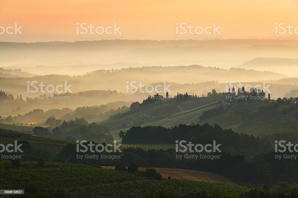 Tuscany - Landscape panorama at sunrise, hills and meadow stock photo