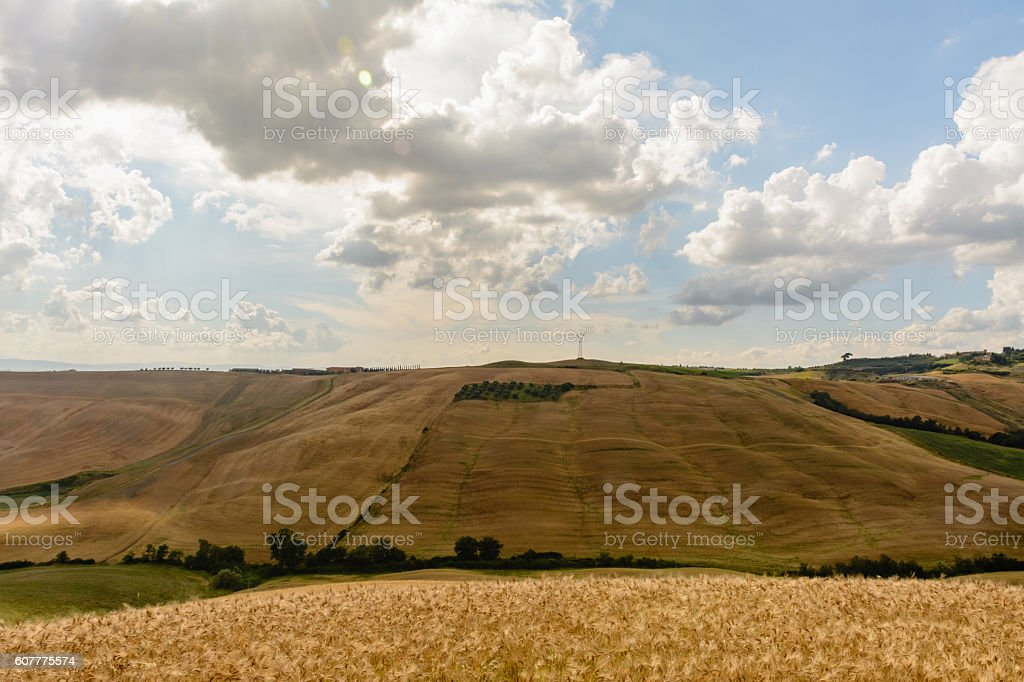 Tuscany landscape with a light pole at the horizon stock photo