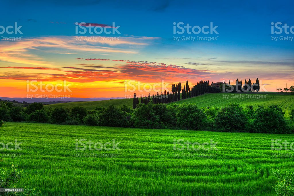 Tuscany Landscape with Farmhouse at Sunset stock photo