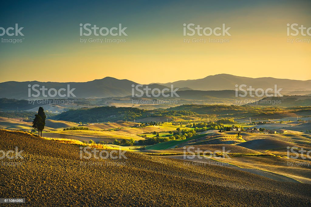 Tuscany Maremma sunset. Trees, farmlands, hills and fields. Ital stock photo