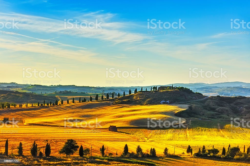 Tuscany, rural landscape. Countryside farm, green fields and cyp stock photo