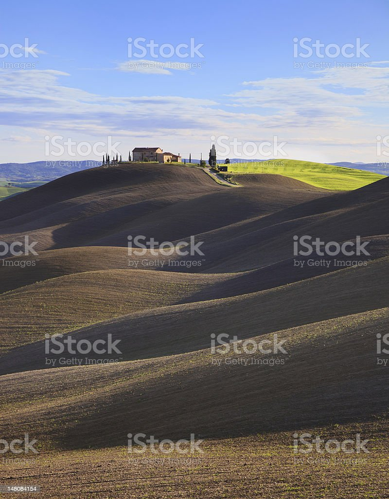 Tuscany, rural  landscape. Rolling hills, countryside farm, trees. Siena, Italy. royalty-free stock photo