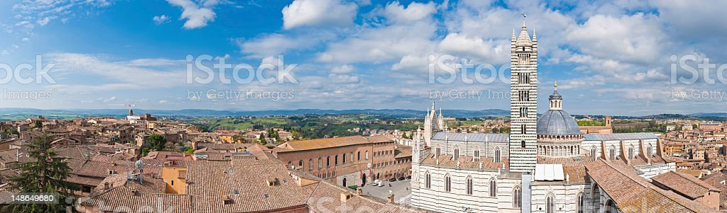 Tuscany Siena rooftop panorama over Duomo piazza campanile villas Italy stock photo