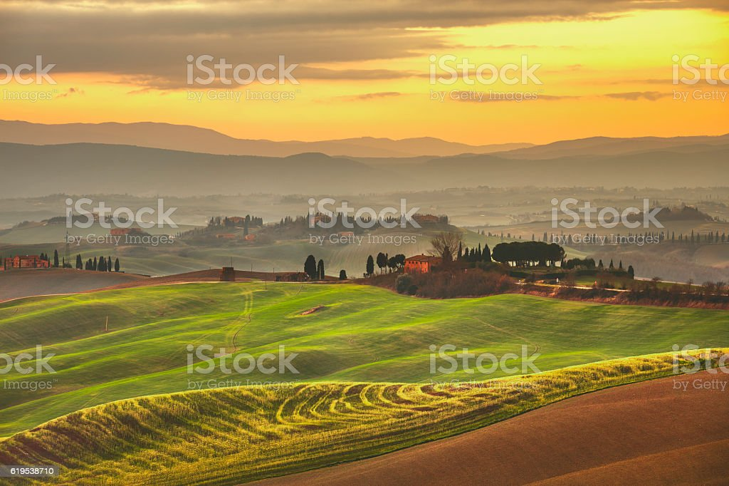 Tuscany spring, rolling hills on misty sunset. Rural landscape. stock photo