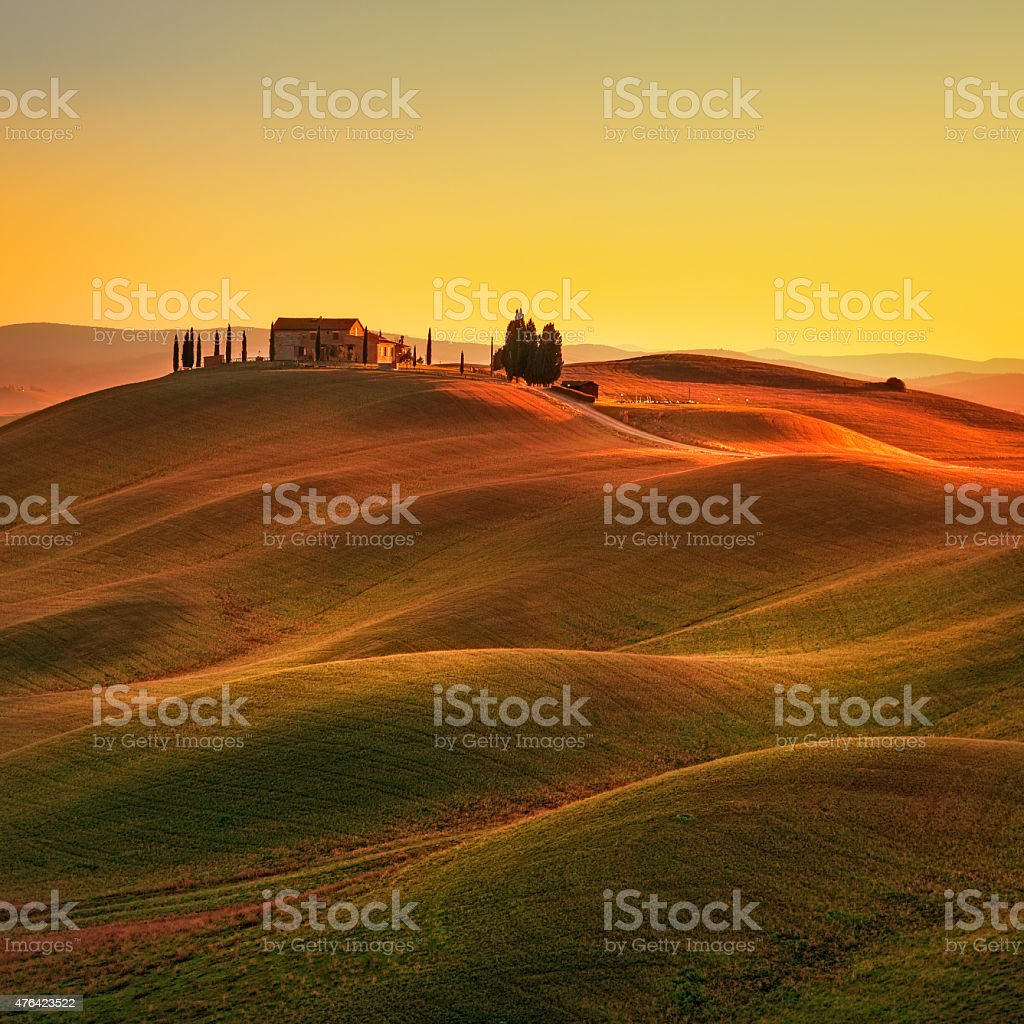 Tuscany, sunset rural landscape. Rolling hills, countryside farm stock photo