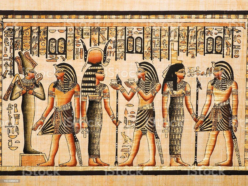 Tutankhamen, Osiris, Hathor and Isis in an Egyptian papyrus stock photo