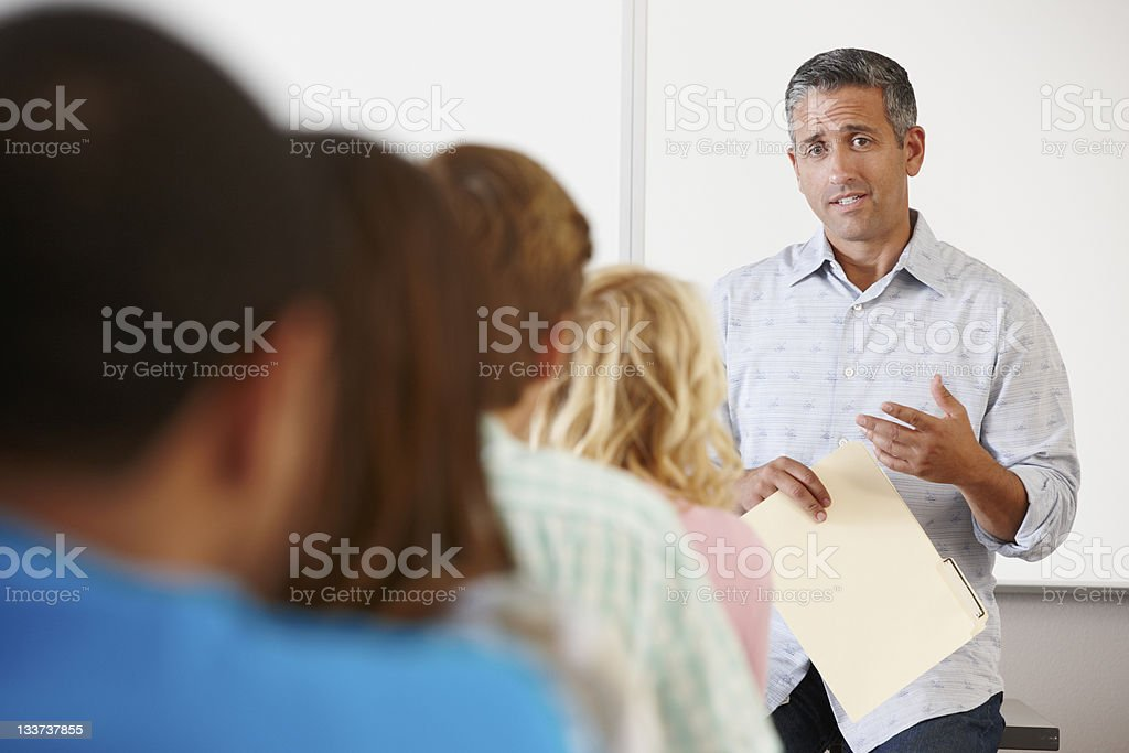 Tutor with class of students stock photo