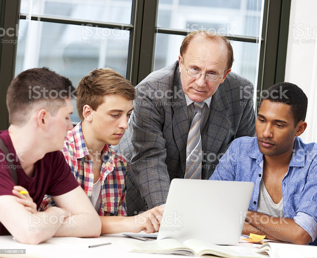 Tutor with his study group royalty-free stock photo