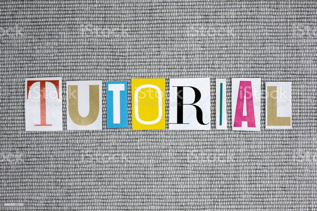 tutorial word on grey background stock photo