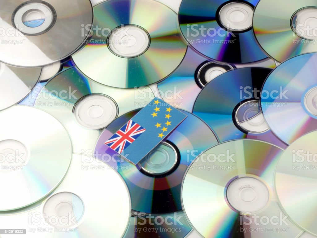 Tuvalu flag on top of CD and DVD pile isolated on white stock photo