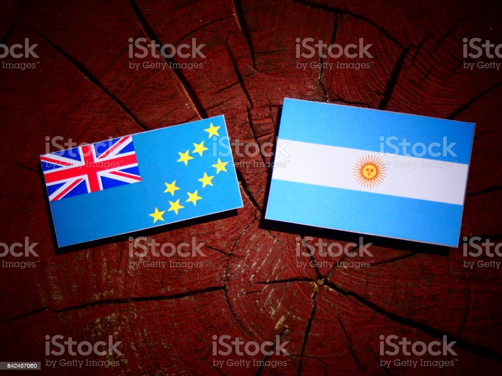 Tuvalu flag with Argentinian flag on a tree stump isolated stock photo