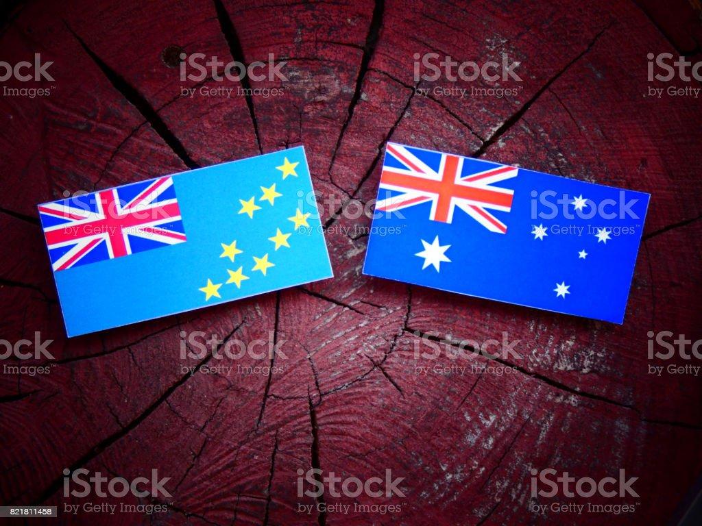Tuvalu flag with Australian flag on a tree stump isolated stock photo
