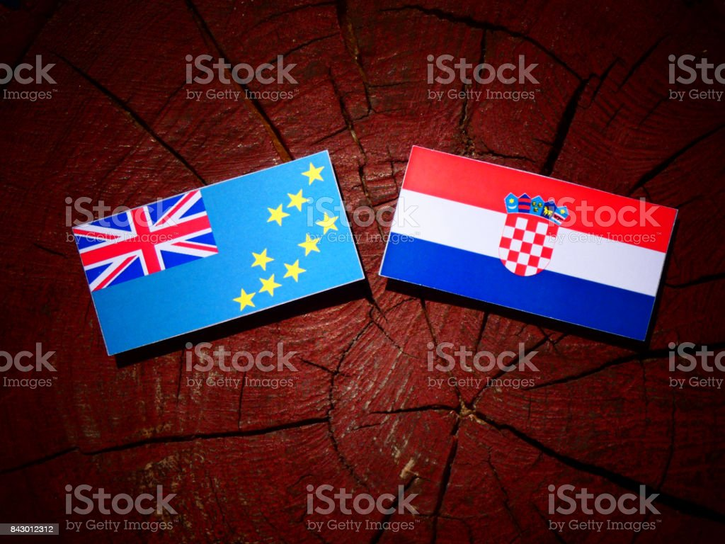 Tuvalu flag with Croatian flag on a tree stump isolated stock photo