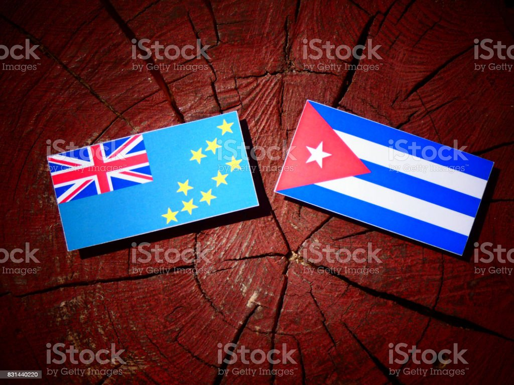 Tuvalu flag with Cuban flag on a tree stump isolated stock photo