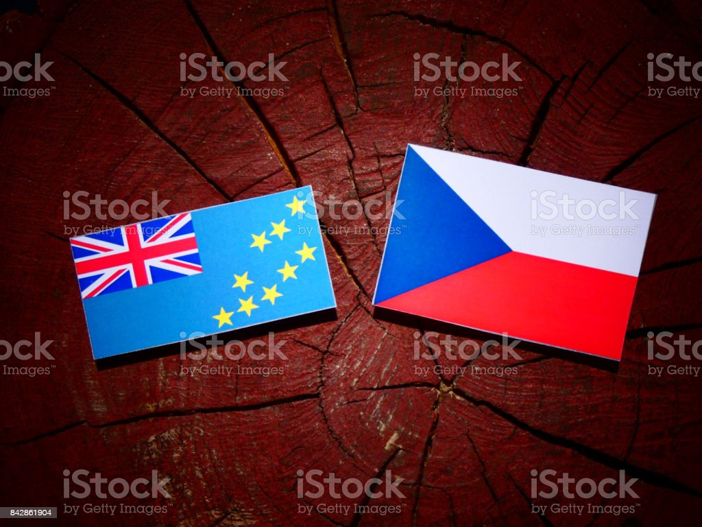Tuvalu flag with Czech flag on a tree stump isolated stock photo