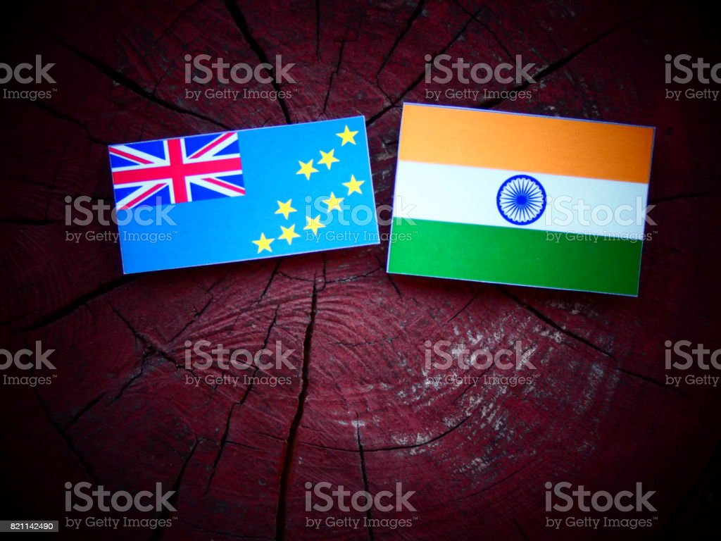 Tuvalu flag with Indian flag on a tree stump isolated stock photo