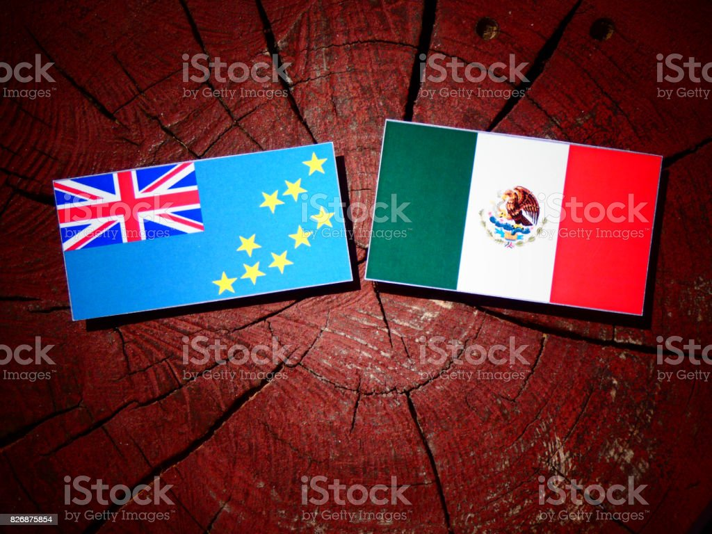 Tuvalu flag with Mexican flag on a tree stump isolated stock photo