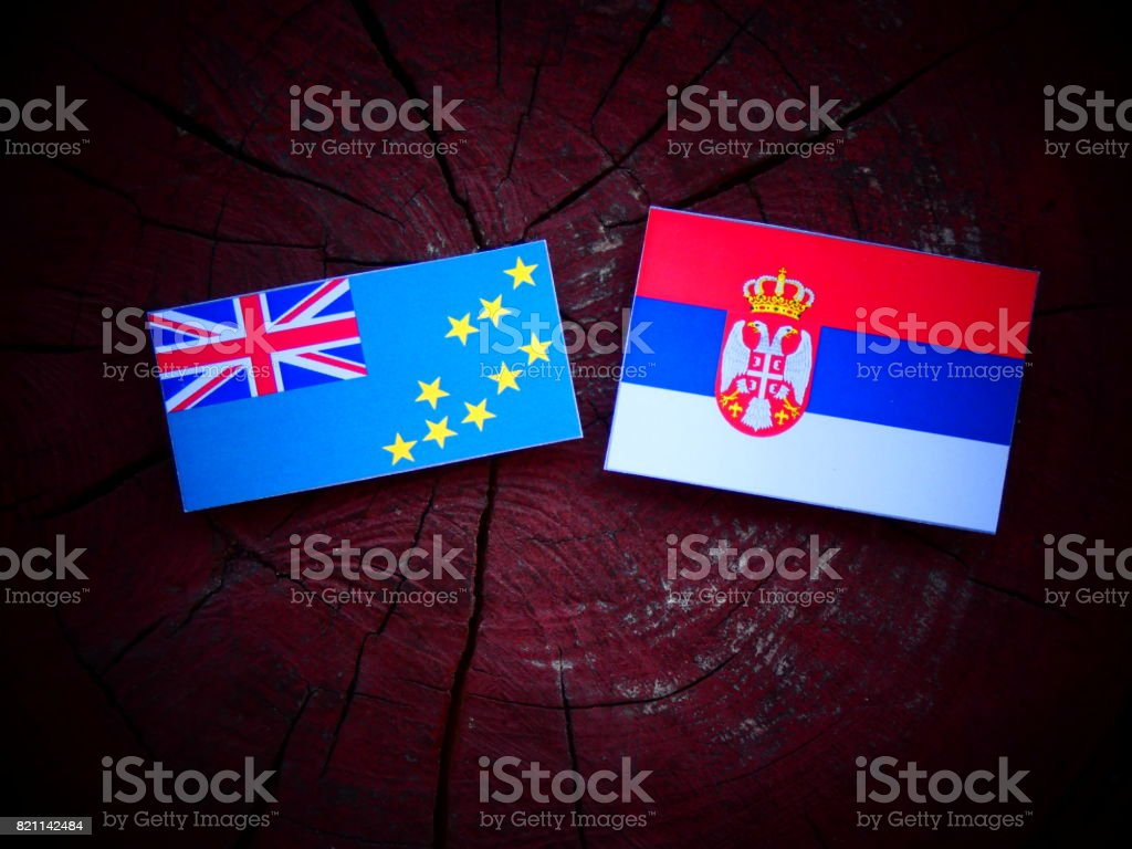 Tuvalu flag with Serbian flag on a tree stump isolated stock photo