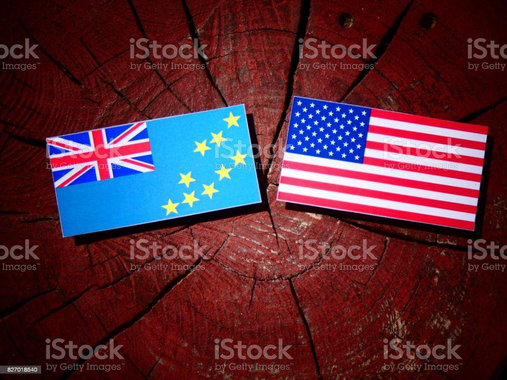 Tuvalu flag with USA flag on a tree stump isolated stock photo