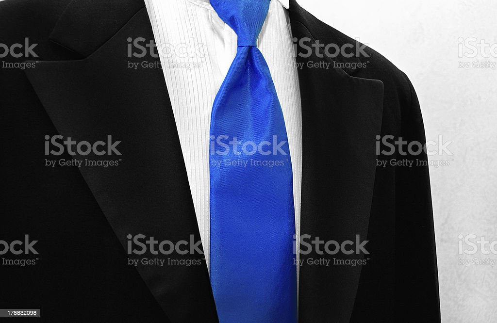 tuxedo with blue tie royalty-free stock photo