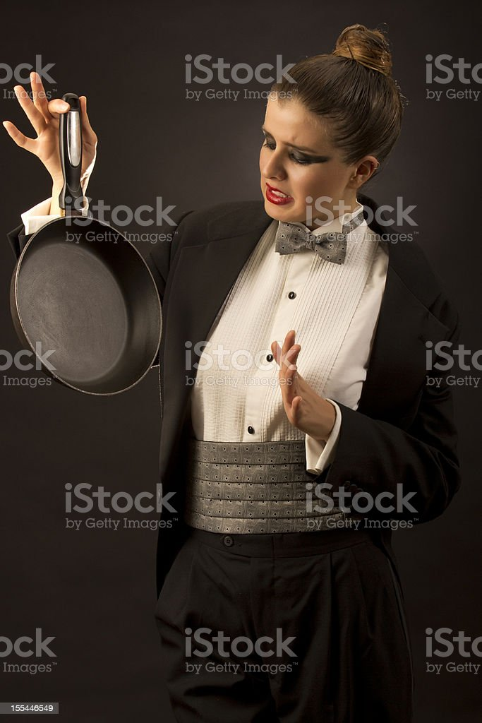 Tuxedo woman refuse the kitchen stock photo
