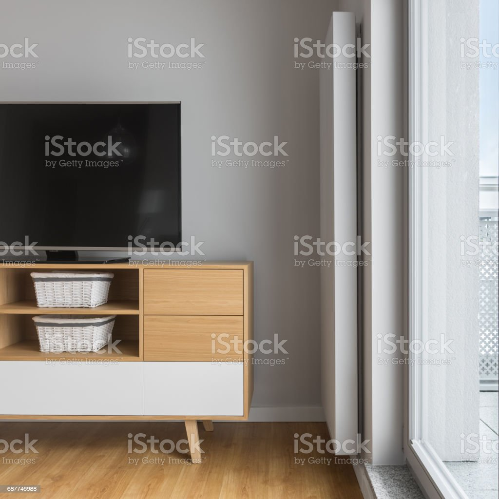 Tv on wooden cabinet stock photo