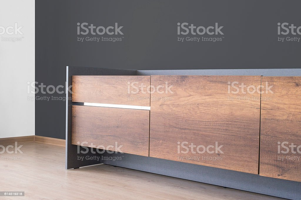 tv stand with dark grey concrete wall stock photo