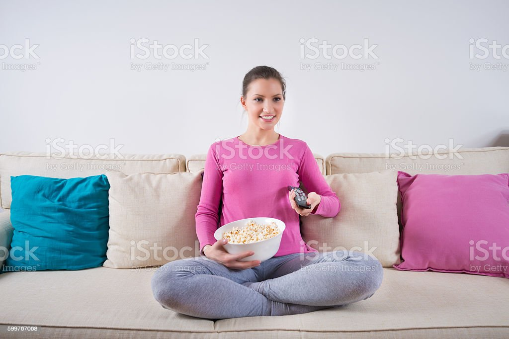 Tv watching and eating popcorn stock photo