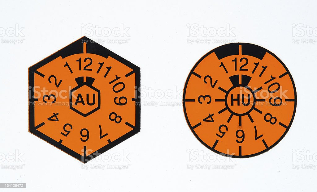 TÜV-seal and AU-badge stock photo