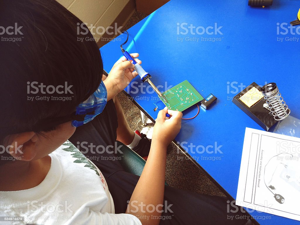 tween building a robot stock photo
